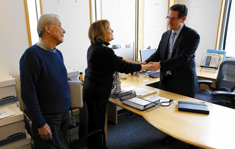 Rick Hirschhaut, right, executive director of the Illinois Holocaust Museum and Education Center, is visited in his office by Board Chairman Aaron Elster, left, and Board Pres. Fritzie Fritzshall on Hirschhaut's last day on the job.