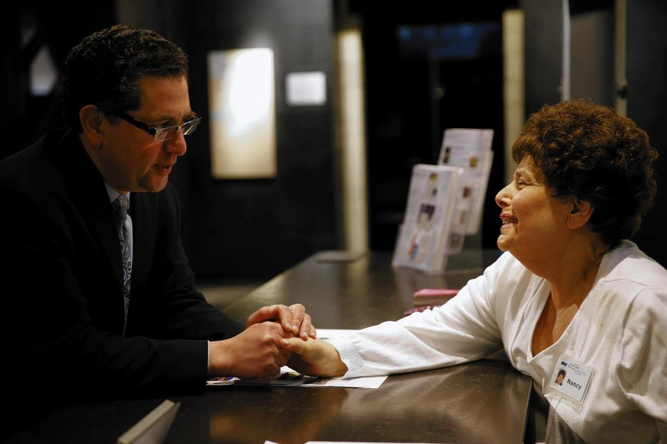 Rick Hirschhaut, left, executive director of the Illinois Holocaust Museum and Education Center, says goodbye to volunteer Nancy Steinfink on Hirschhaut's last day on the job.