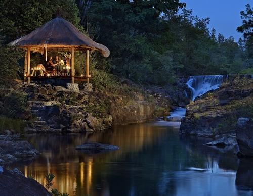 Tucked away in a pocket of the Maya Mountains, Blancaneaux Lodge is a 20-room luxury resort where waterfalls tumble into natural pools above the jungle canopy.