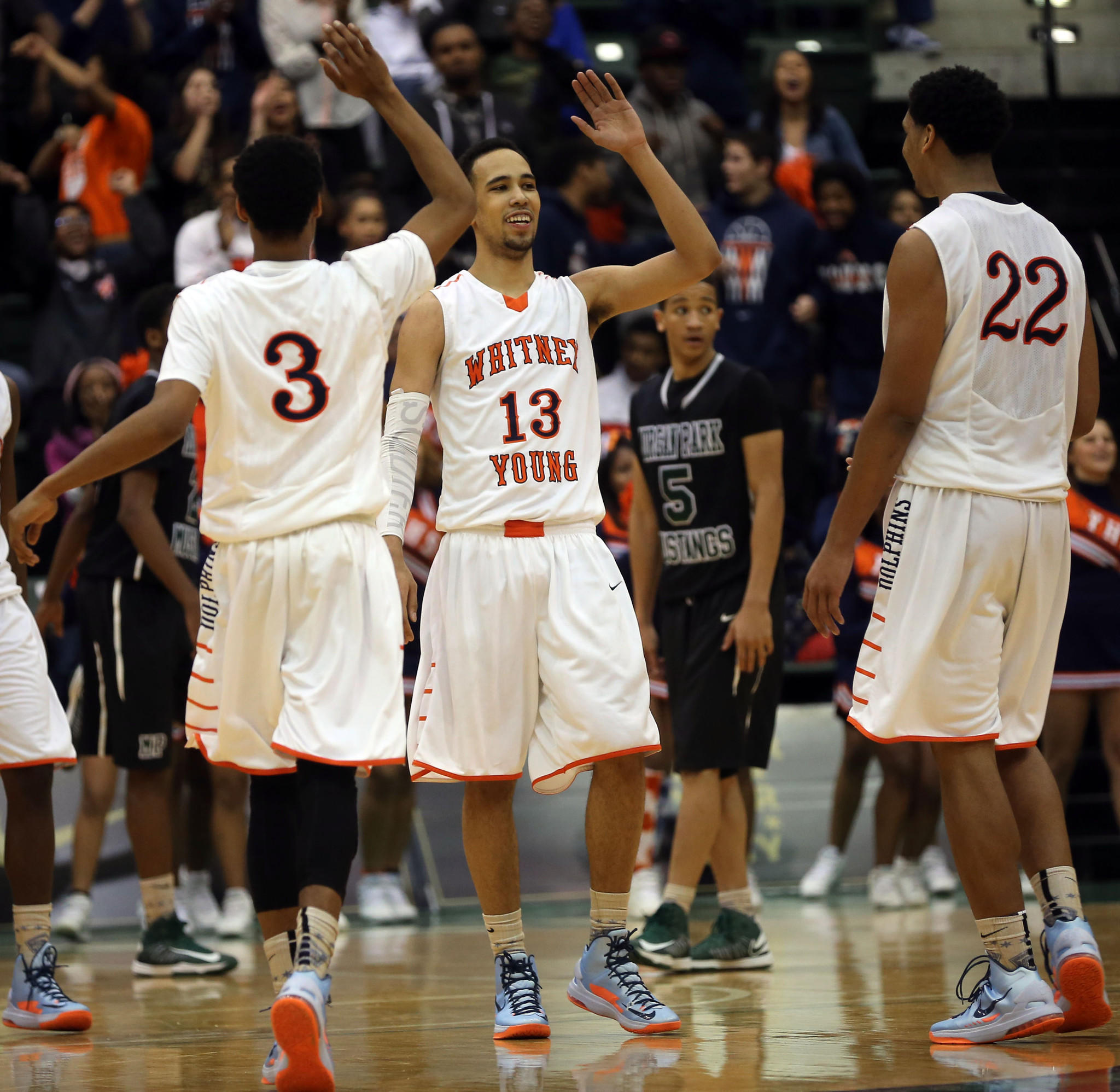 Whitney Young's Miles Reynolds (3), Paul White (13) and Jahlil Okafor (22) celebrate their victory over Morgan Park in the boys basketball Chicago Public League final on Friday, Feb. 15, 2013 at Chicago State University.