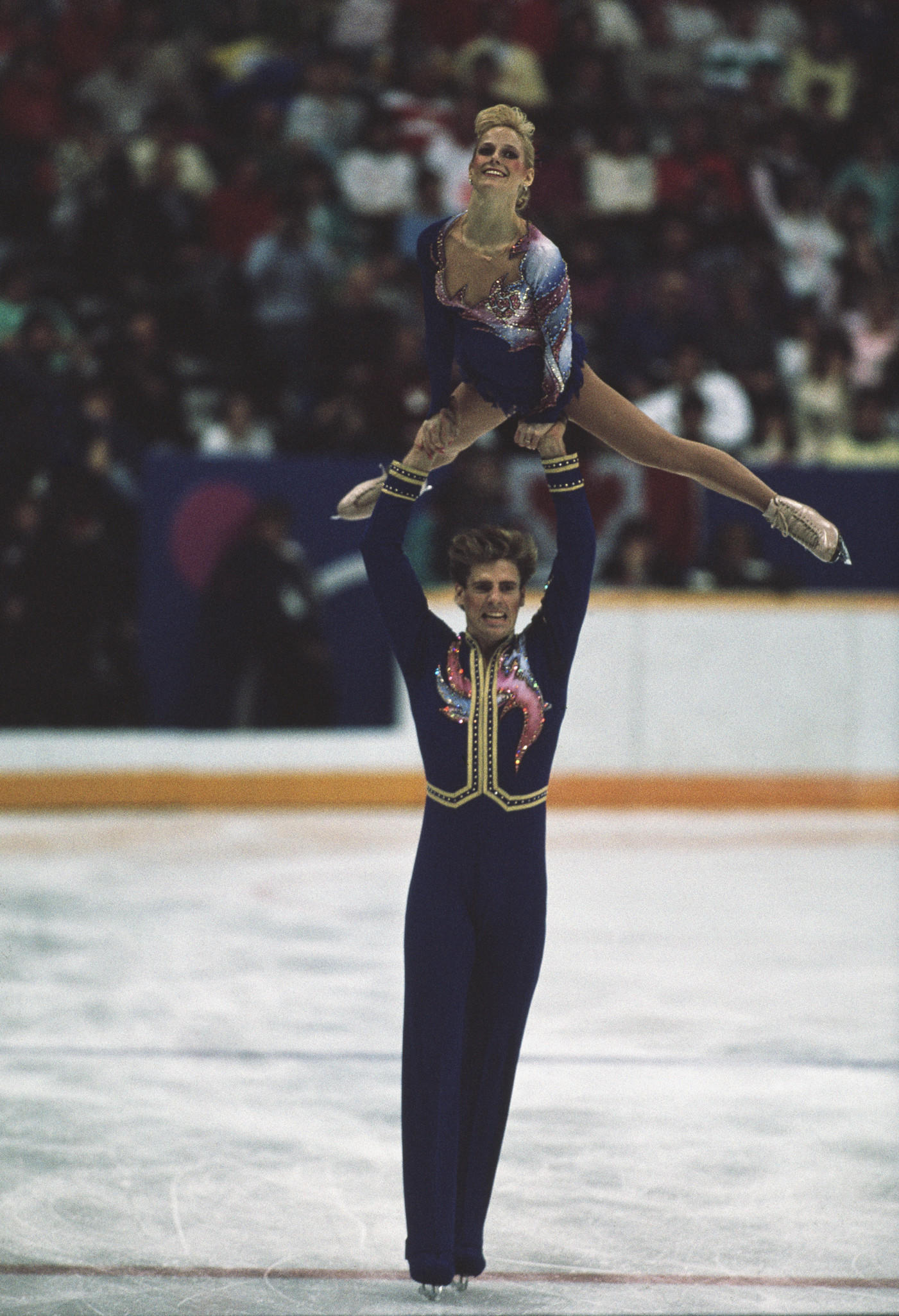 Jill Watson is lifted by partner Peter Oppegard at the 1988 Olympics in Calgary. (Mike Powell/Getty Photo)