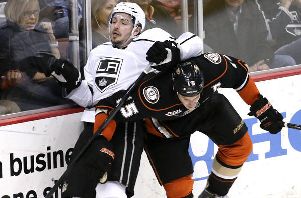 Ducks center Ryan Getzlaf (15) and Kings defenseman Drew Doughty will join forces for Canada during the 2014 Winter Olympics in Sochi, Russia.