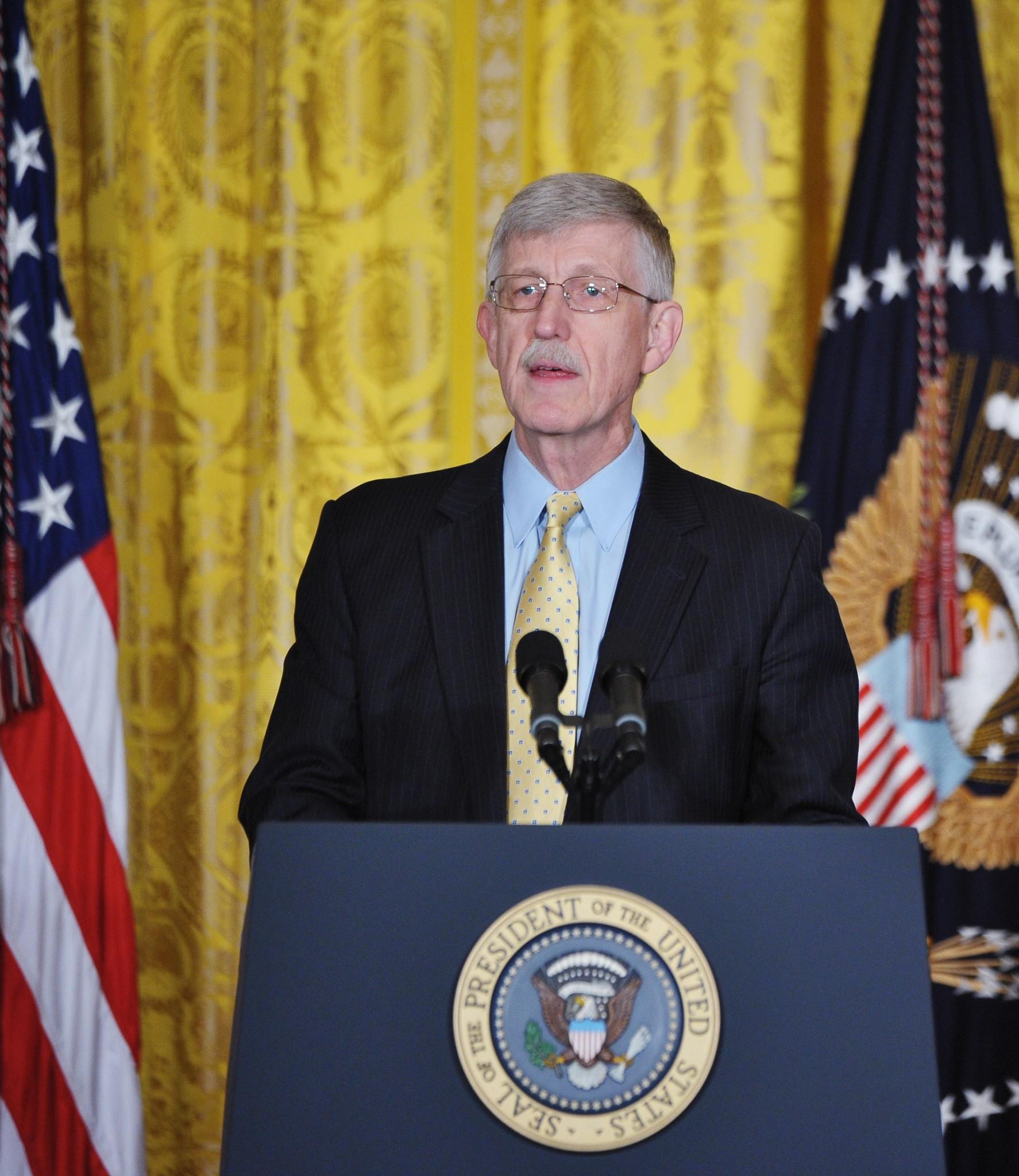 Director of the National Institutes of Health, Francis Collins introduces President Barack Obama before Obama spoke on the Brain Research through Advancing Innovative Neurotechnologies (BRAIN) Initiative on April 2, 2013 in the East Room of the White House in Washington, DC.