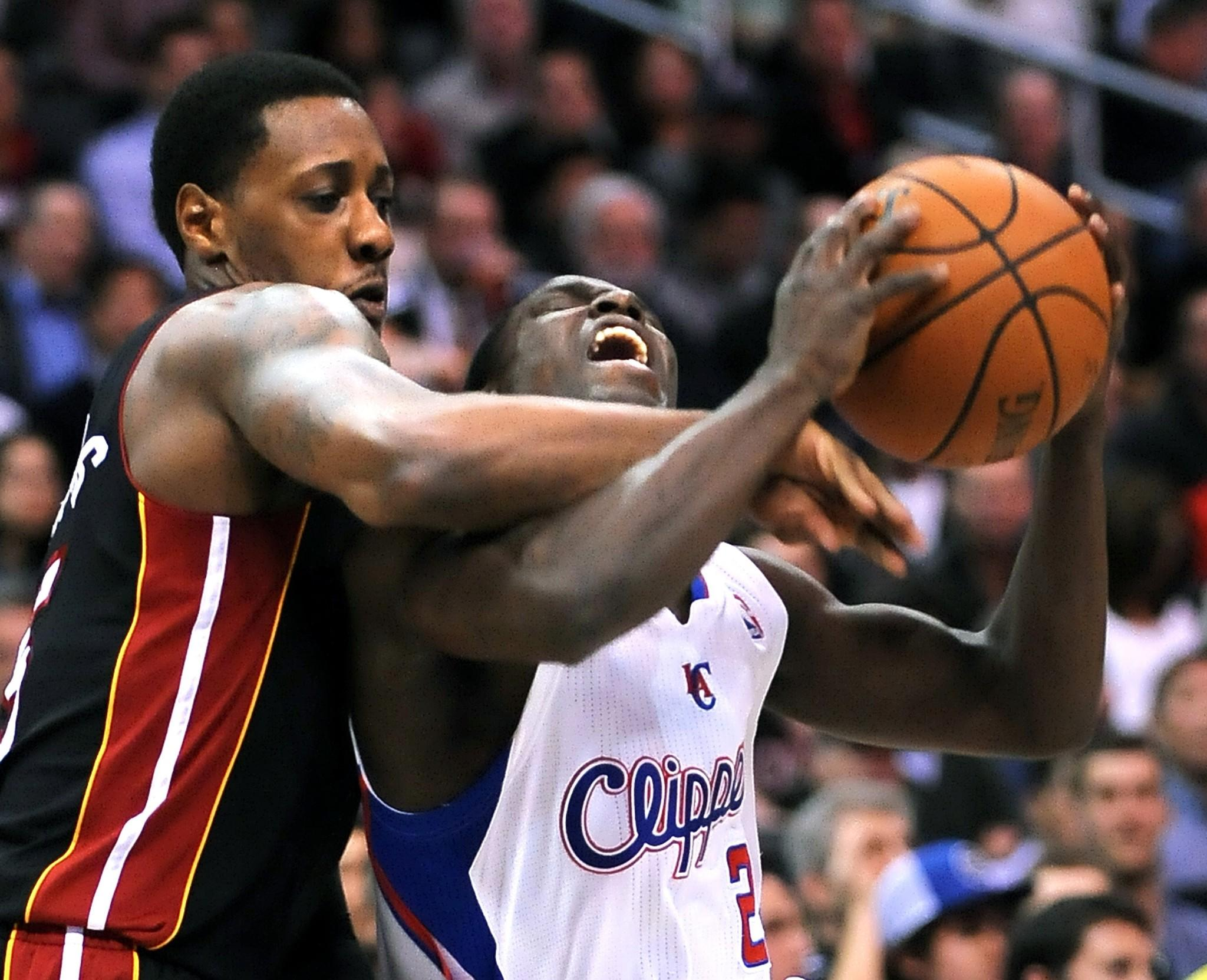 Miami's Mario Chalmers fouls Darren Collison during the Clippers' 116-112 loss Wednesday to the Heat at Staples Center.