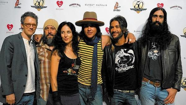 Jonny Kaplan, center with cowboy hat, and the Lazy Stars will perform at the Harp Inn in Costa Mesa Friday night.