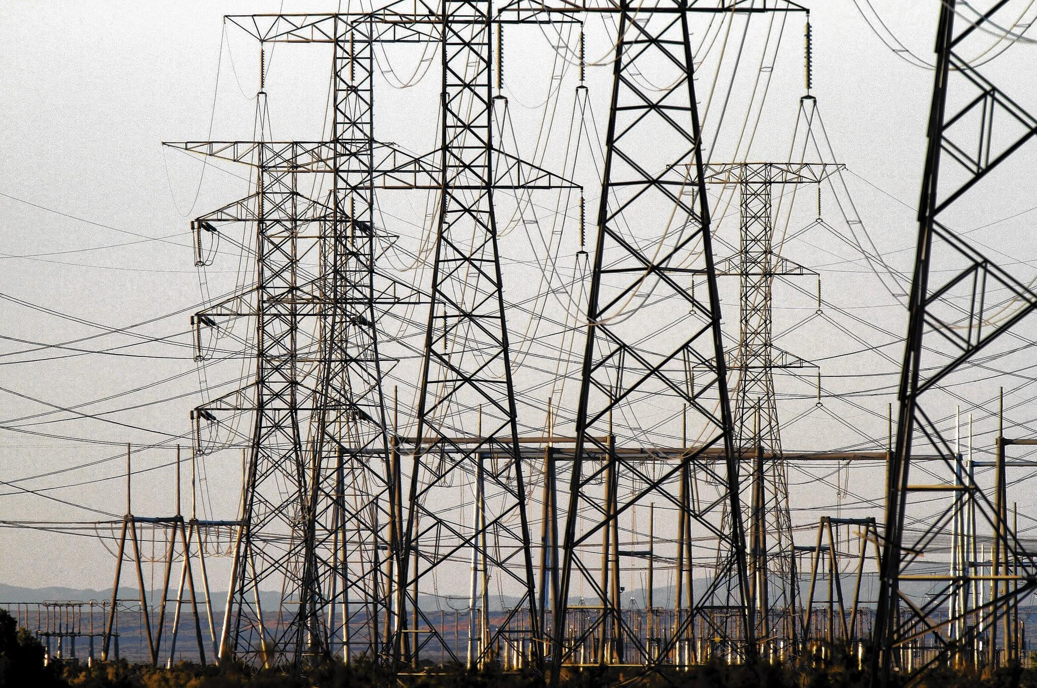 "A National Research Council committee issued a 2007 report warning how easy it would be for a criminal enterprise to knock out the power grid in a way that ""could deny large regions of the country access to bulk power systems for weeks or even months,"" leading to ""turmoil, widespread public fear and an image of helplessness that would play directly into the hands of terrorists."" Above, electiricity transmission towers cross the Yuha Desert in western Imperial County."