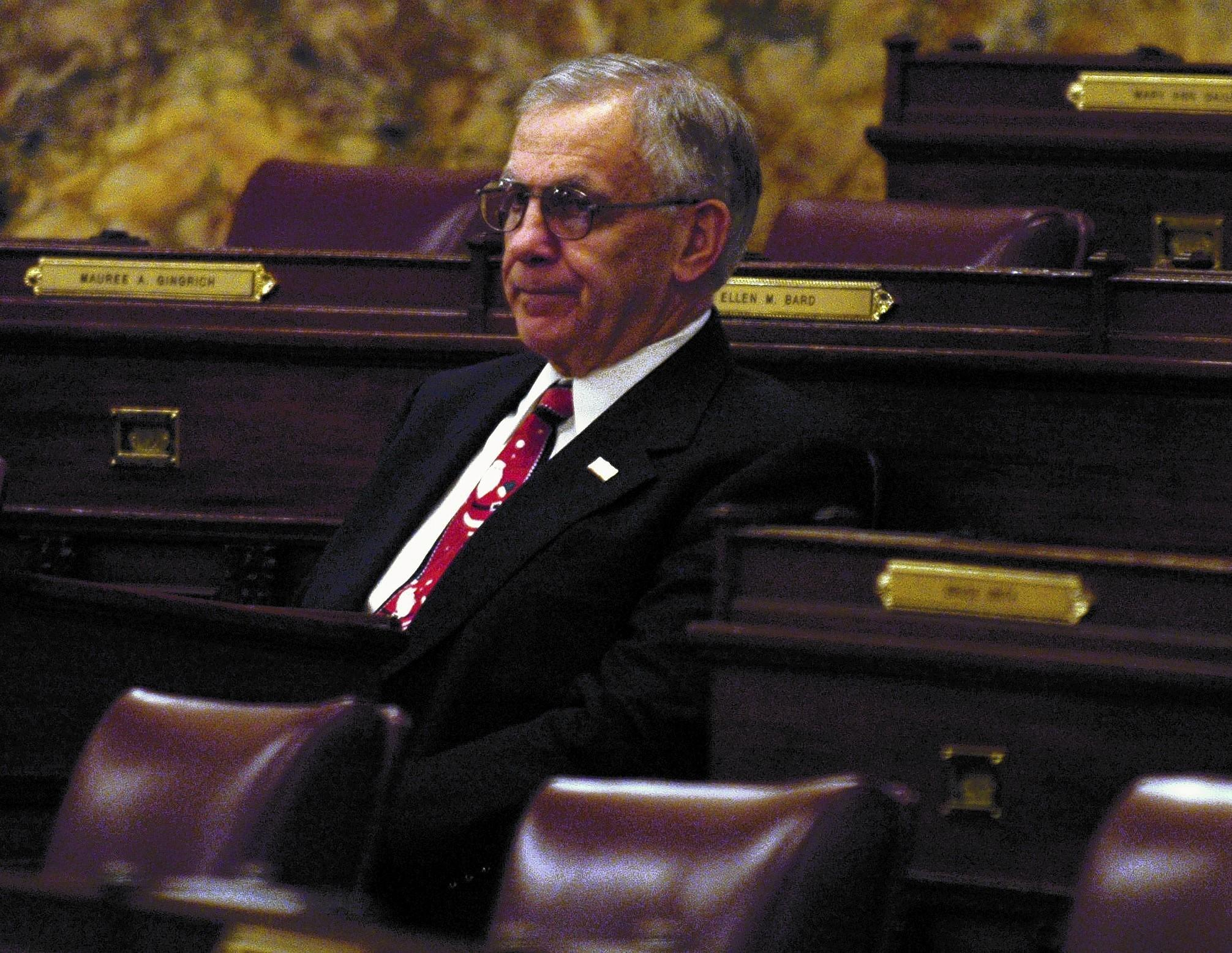 State Rep. Paul Clymer, R-Bucks, shown at his seat in Harrisburg, may facilitate the consideration of legislation to help students threatened by perfume allergies.