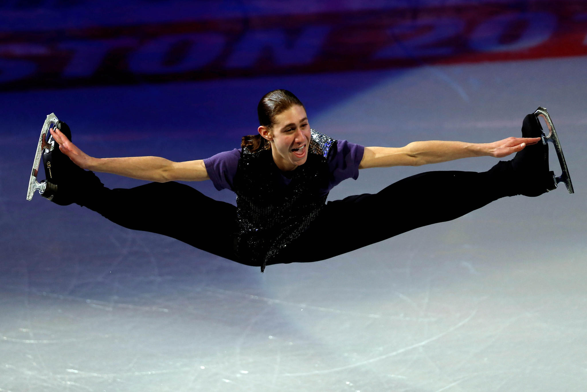 Jason Brown does a split jump in the exhibition gala at the 2014 U.S. Championships.