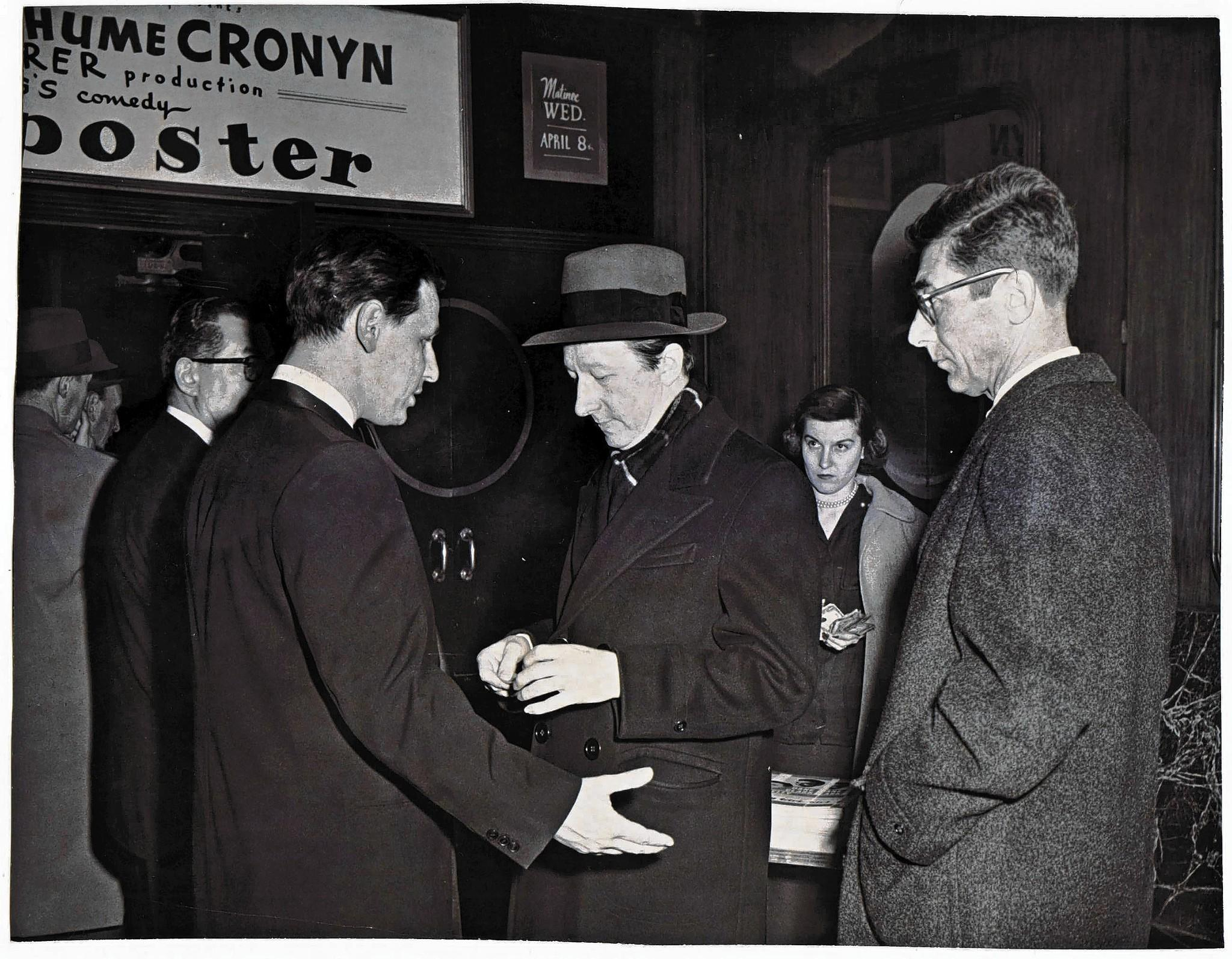 The Courant's Theater Critic T. H. Parker, center (with hat), is shown being denied admission to the New Parsons Theater.