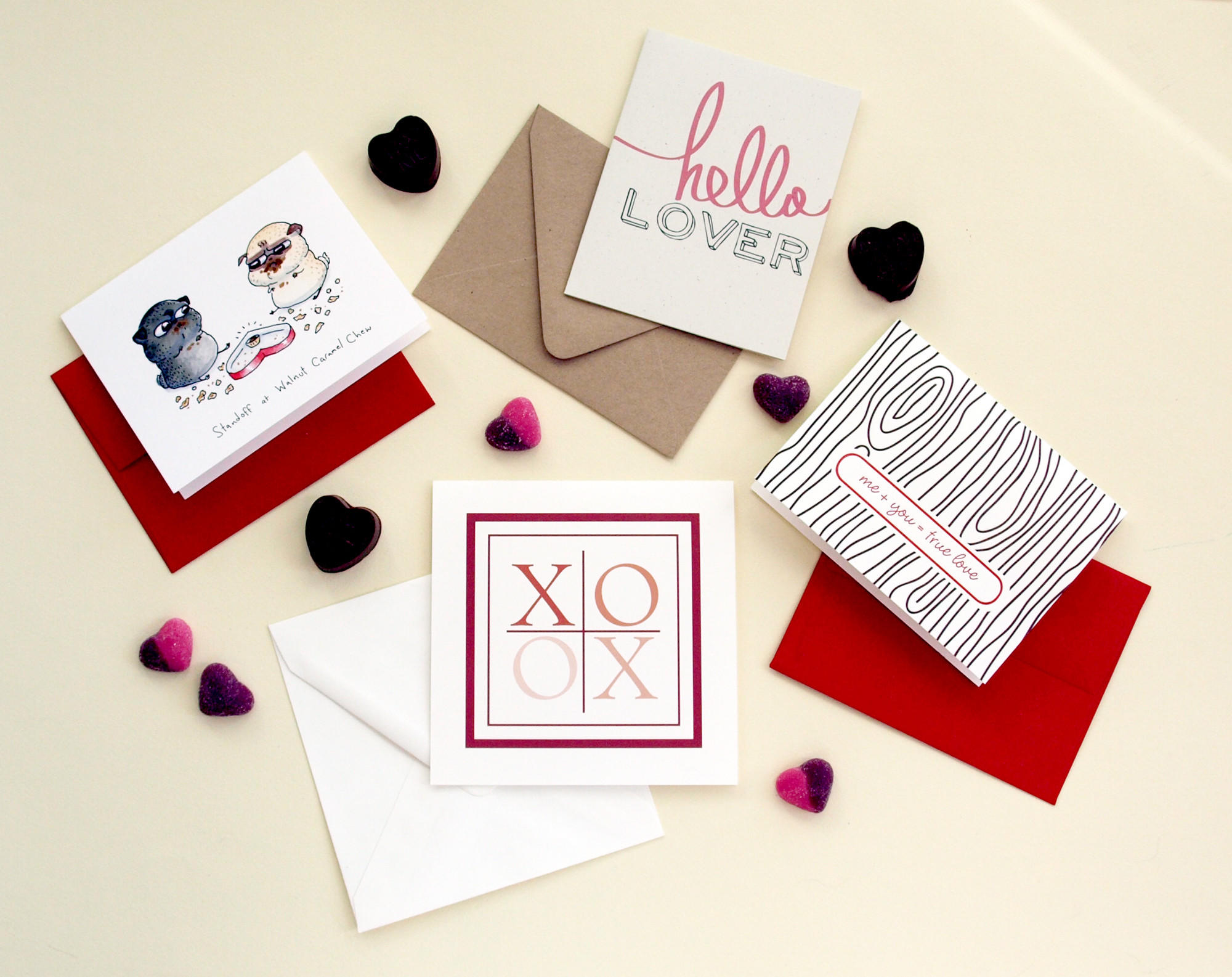 "Available through Etsy (clockwise from left): ""Standoff at Walnut Caramel Chew"" card by InkPug ($4); ""Hello Lover"" card by Ms Matilda Designs ($4); ""Wood Grain-Me Plus You Equals True Love"" letterpress card by The Paper Peony ($4); ""XOXO Four Square"" card by Spiffy Salutations ($4)"