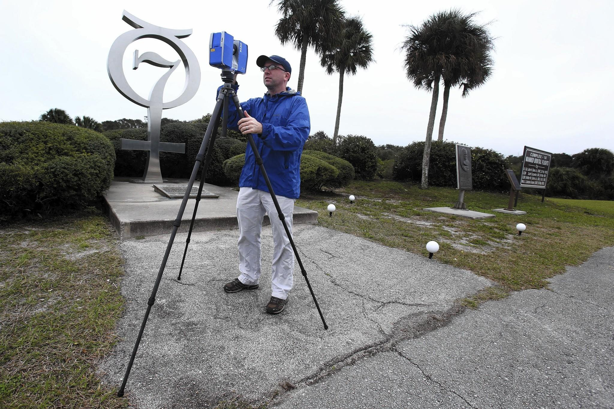 Jeff DuVernay sets up a terrestrial laser scanner to make detailed 3-D image of launch complex 14 at Cape Canaveral Air Force Station on Friday February 7, 2014.