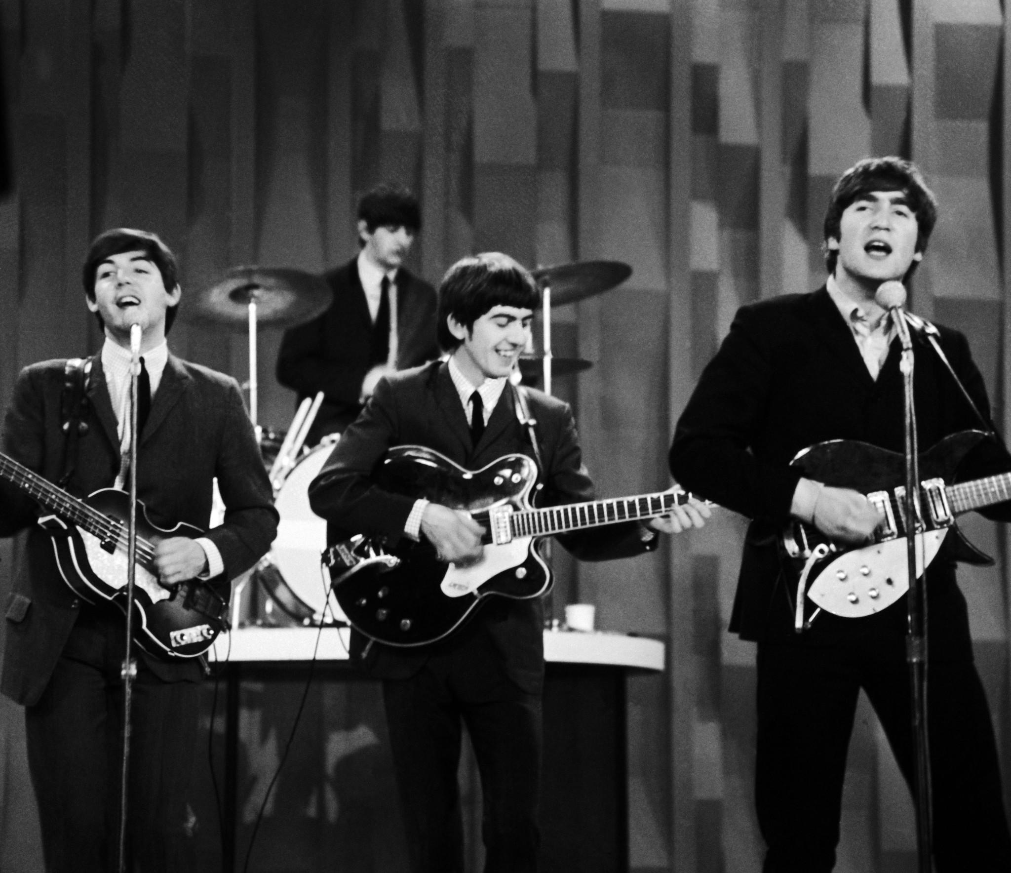 "The Beatles made their first broadcast appearance on ""The Ed Sullivan Show,"" America's must-see weekly variety show, officially kicking off Beatlemania."