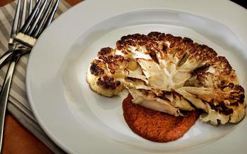 Cauliflower steaks with romesco sauce