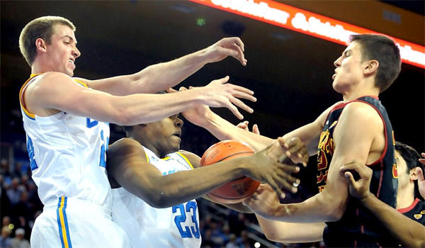 UCLA's Travis Wear, left, and Tony Parker, center, battle for a rebound with USC's Nikola Jovanovic during the Bruins' 107-73 victory over the Trojans in their first meeting of the season.