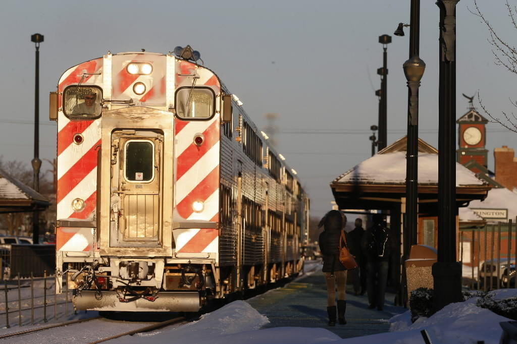 Commuters board a Union Pacific Northwest train at the Barrington station Jan. 21.