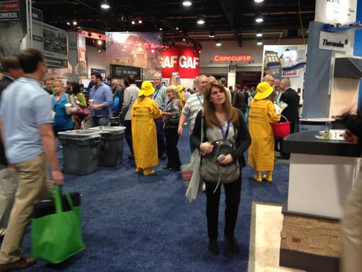 Models in rain hats, coats and boots handed out rubber ducks to promote CertainTeed's Smartbatt fiberglass insulation, which regulates moisture in walls.
