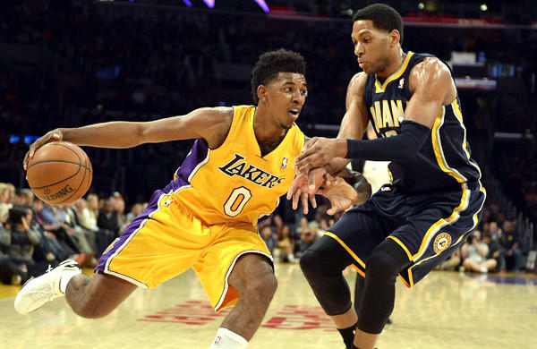 Lakers forward Nick Young drives against Pacers forward Danny Granger during a game last week at Staples Center.