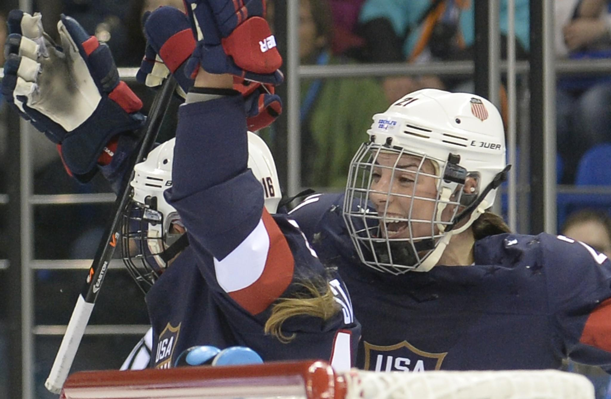 U.S. women's hockey player Hilary Knight congratulates Kelli Stack after Stack scored against Finland.