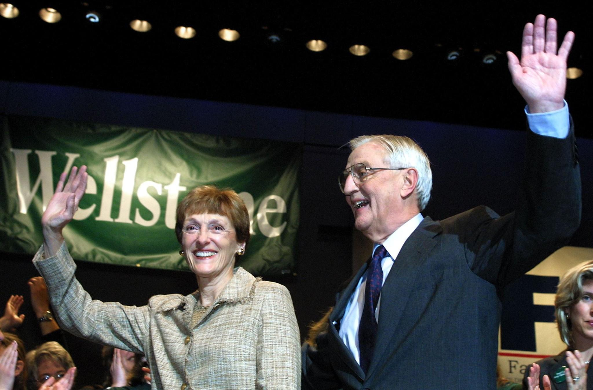 Walter Mondale (L) and his wife Joan Mondale wave to the crowd after the former US vice-president gave his acceptance speech as the candidate for US Senate for the DFL, in this September 30,2002 file photo at the State Theater in Minneapolis, Minnesota.