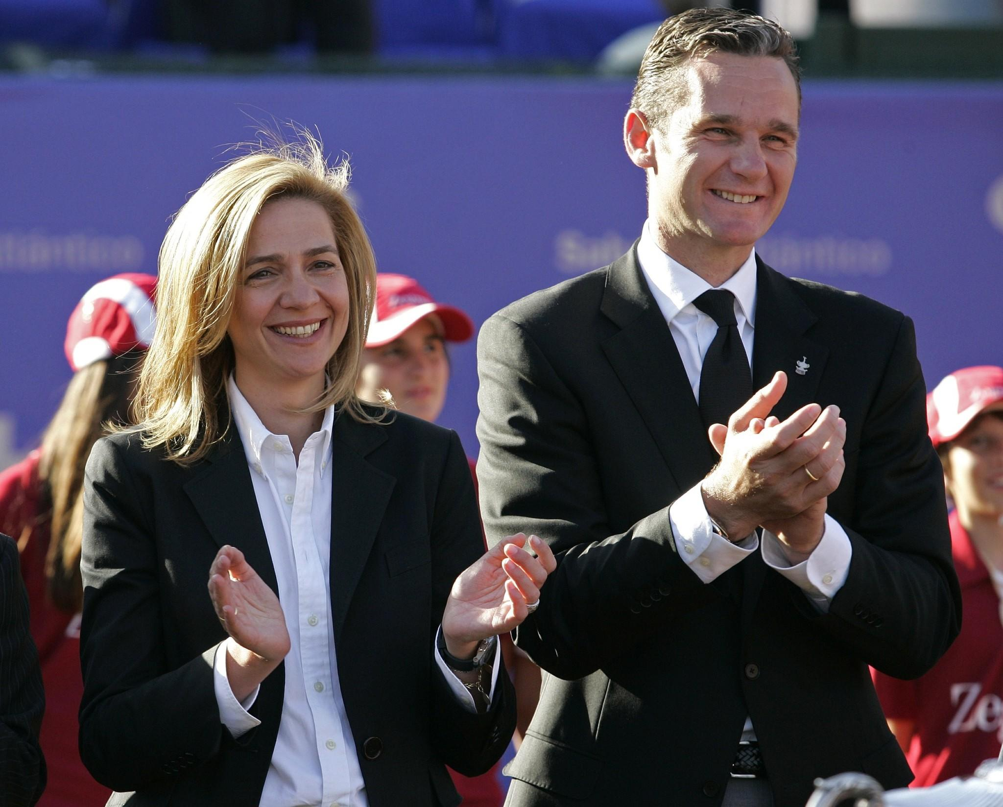 Spanish Princess Infanta Cristina (L) and her husband Inaki Urdangarin applaud after giving a trophy to Spanish Rafael Nadal (not pictured) after the final match of the Barcelona Open tennis tournament Conde de Godo on May 04, 2008 Barcelona. A judge will quiz Spanish King Juan Carlos's youngest daughter Cristina on February 8, over fraud allegations in a corruption scandal linked to the business affairs of Cristina's husband, former Olympic handball player Inaki Urdangarin, 46.