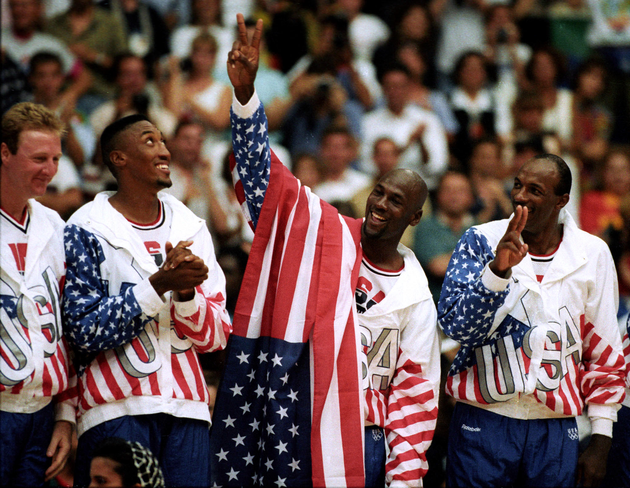 Members of the U.S. basketball team Larry Bird (from left), Scottie Pippen, Michael Jordan and Clyde Drexler celebrate after winning the gold medal during the 1992 Summer Olympic Games in Barcelona.