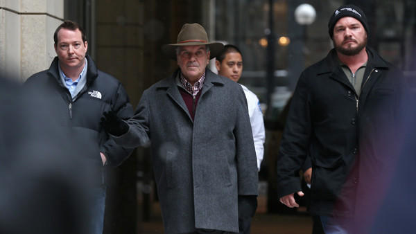 Former Mayor Richard M. Daley, middle, exits Northwestern Memorial Hospital Saturday, Feb. 8, 2014, in Chicago. Daley was admitted for more than a week after returning from a business trip in Arizona.