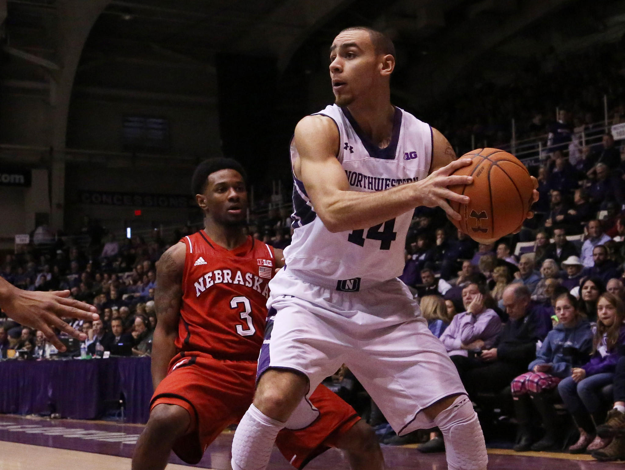 Northwestern guard Tre Demps is defended by Nebraska guard Benny Parker during the first half at Welsh-Ryan Arena.