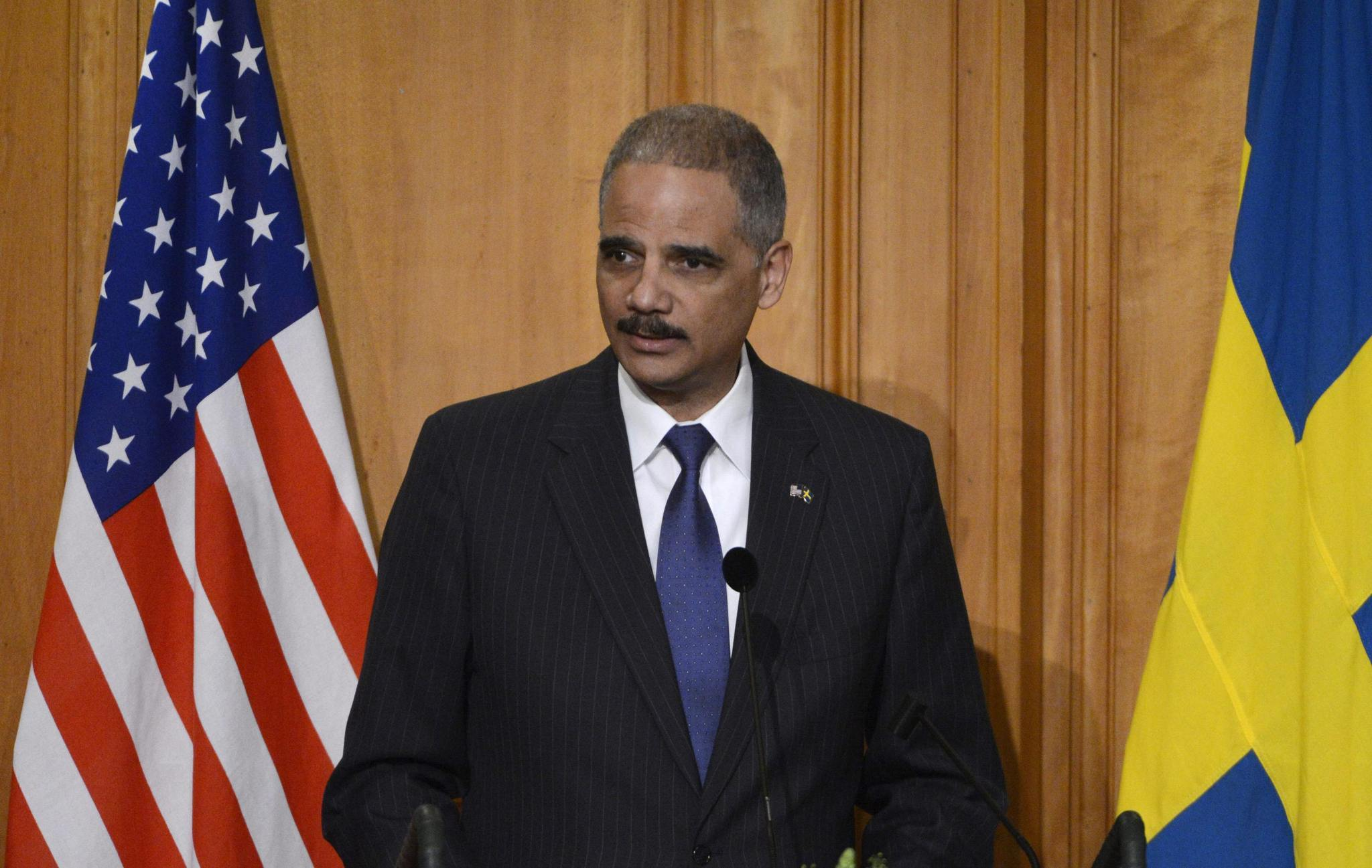 Attorney-General Eric Holder delivers a speech at the Swedish Parliament in Stockholm Feb. 4, 2014.
