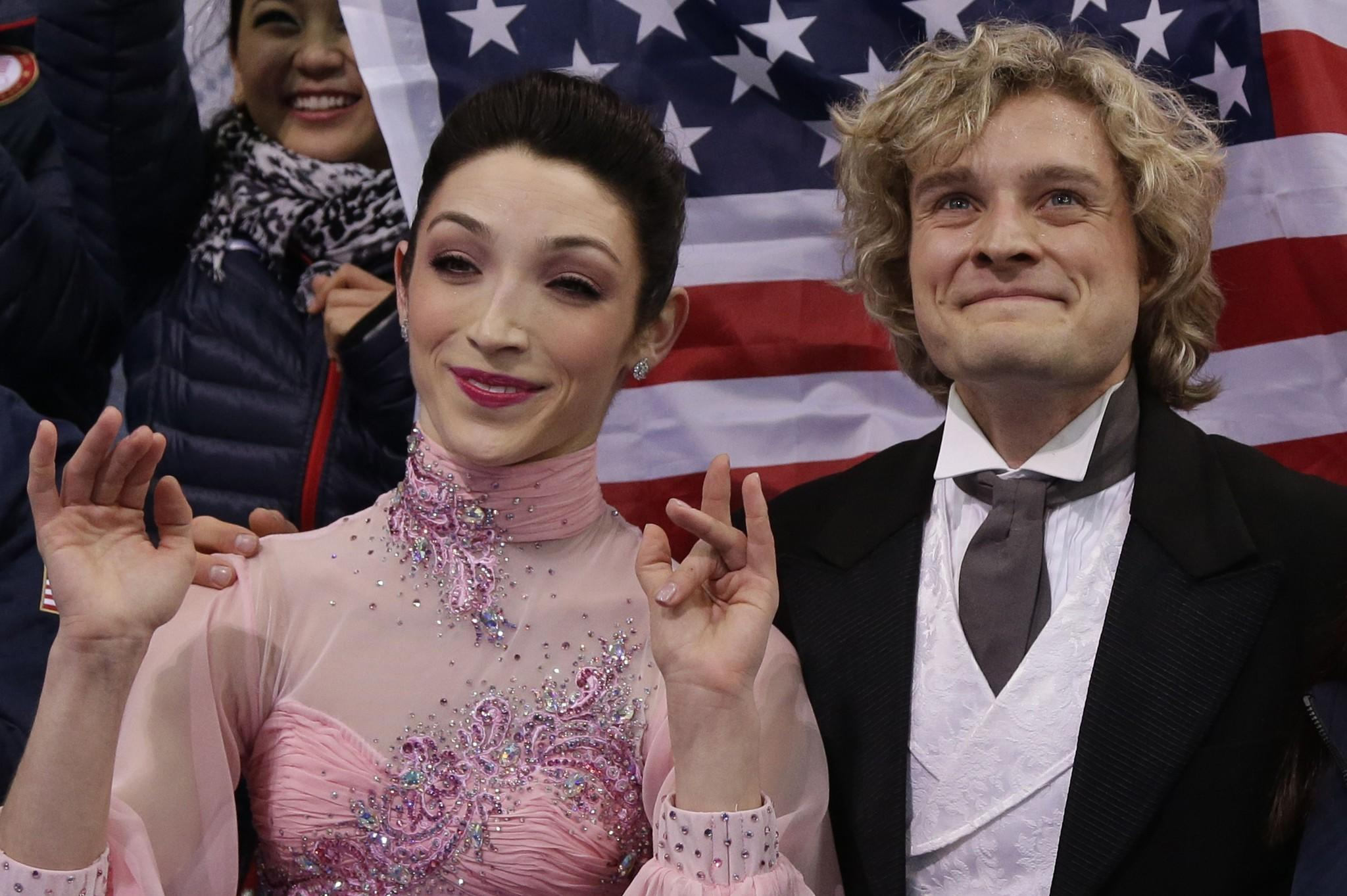 Meryl Davis (left) and Charlie White celebrate after performing in the Figure Skating Team Ice Dance Short Dance at the Iceberg Skating Palace.