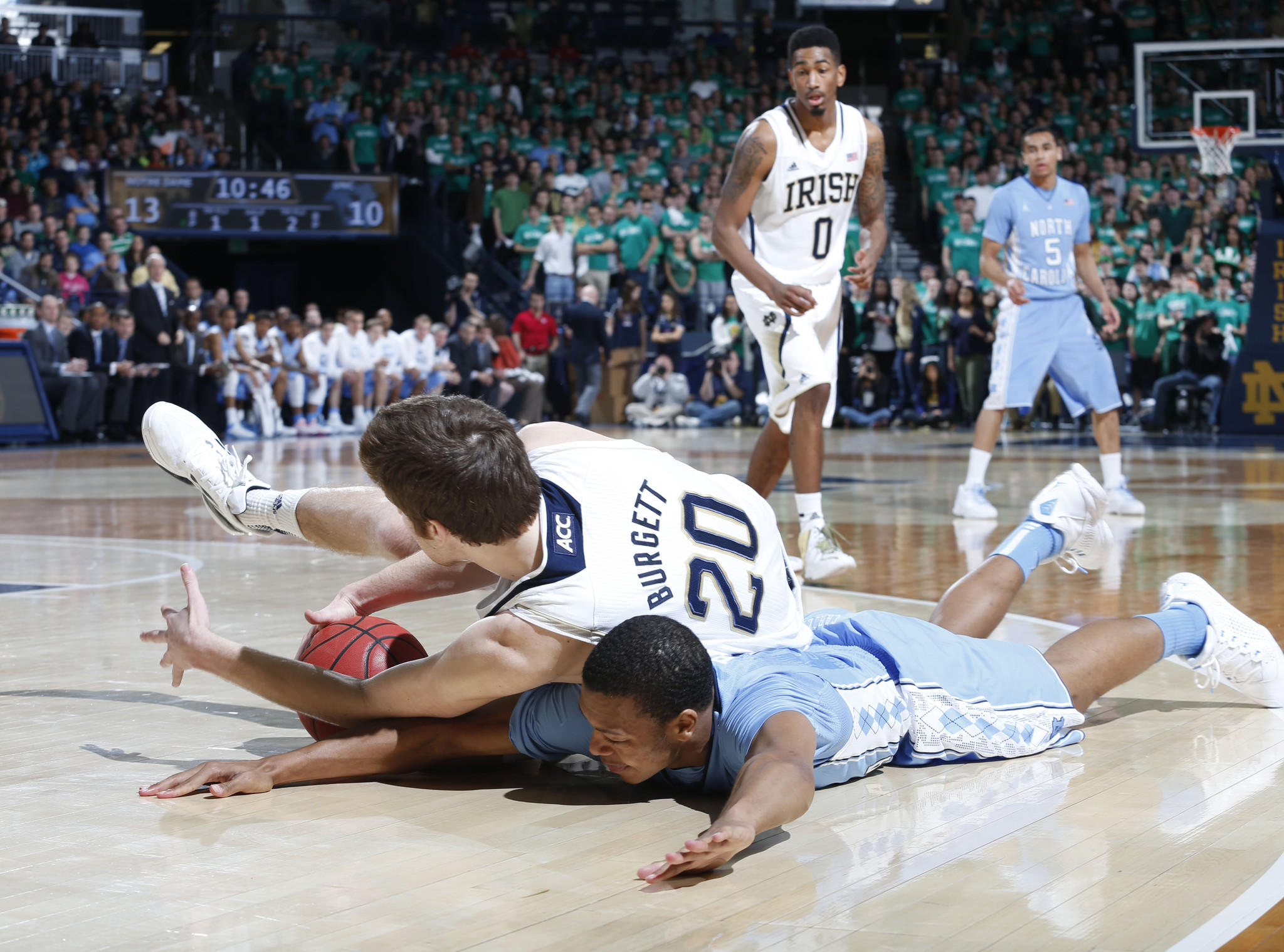 North Carolina guard Nate Britt scrambles for a loose ball against Notre Dame forward Austin Burgett.