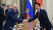 Vladimir Putin and Shinzo Abe meet in Sochi