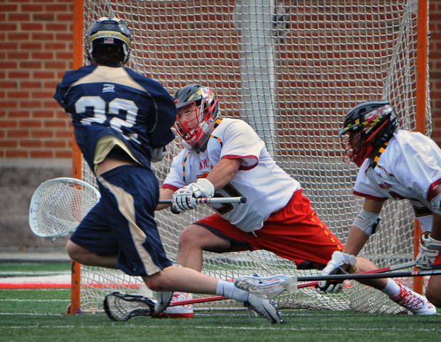 Mount St. Mary's Bubba Johnson beats Maryland's Niko Amato for a goal in the first quarter.