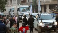 Syria aid convoy bound for Homs comes under attack