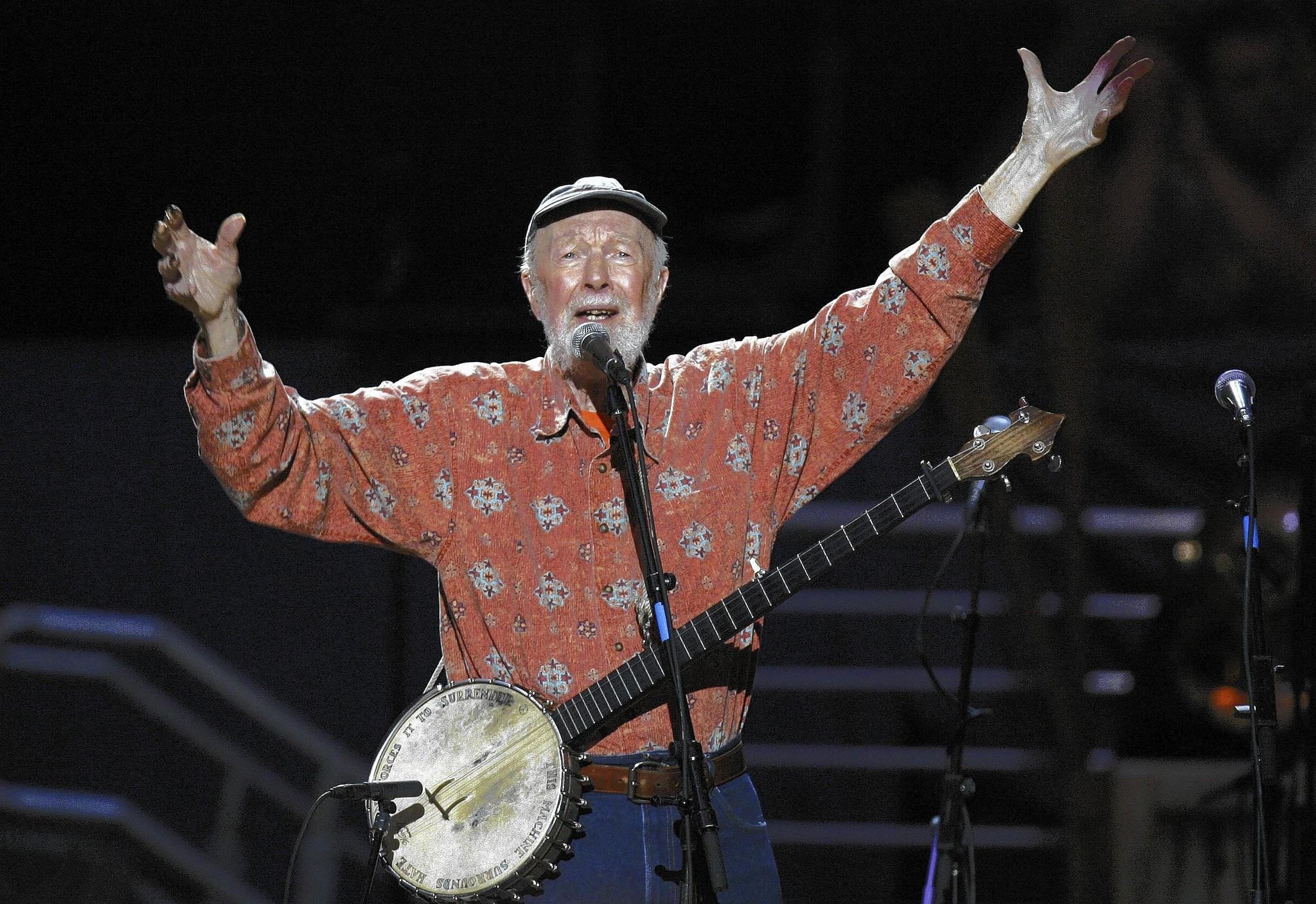 Musician Pete Seeger, shown celebrating his 90th birthday, died Jan. 27 at the age of 94. There now are efforts to have a Hudson River bridge named for him.
