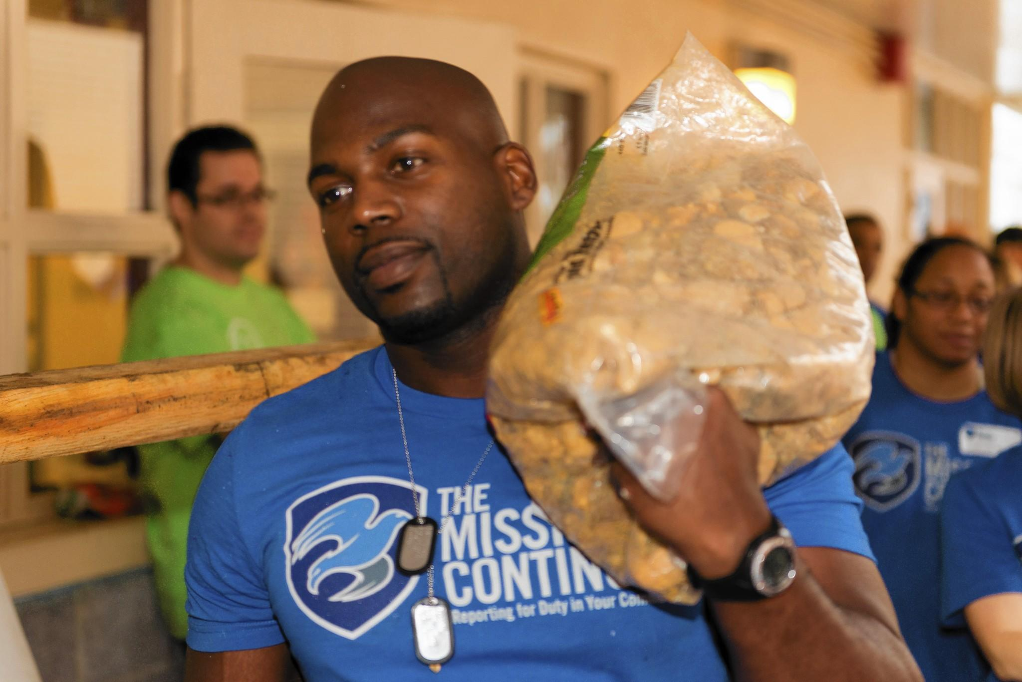 Former Marine Pernell Bush, 26, of Sanford helps renovate the south Orlando Quest Inc. campus on Saturday.