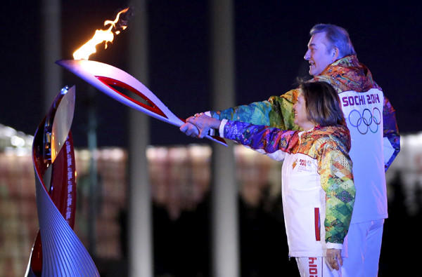 Russia's torchbearers Irina Rodnina and Vladislav Tretyak prepare to light the Olympic cauldron at the opening ceremony on Friday.