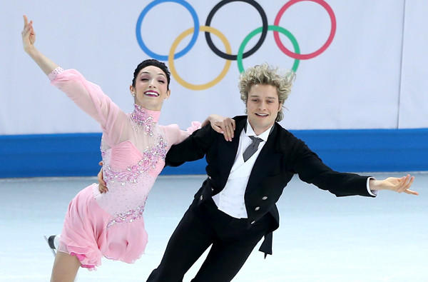 American Meryl Davis and Charlie White perform their short dance routine as part of the team figure skating competition on Saturday at Iceberg Skating Palace.