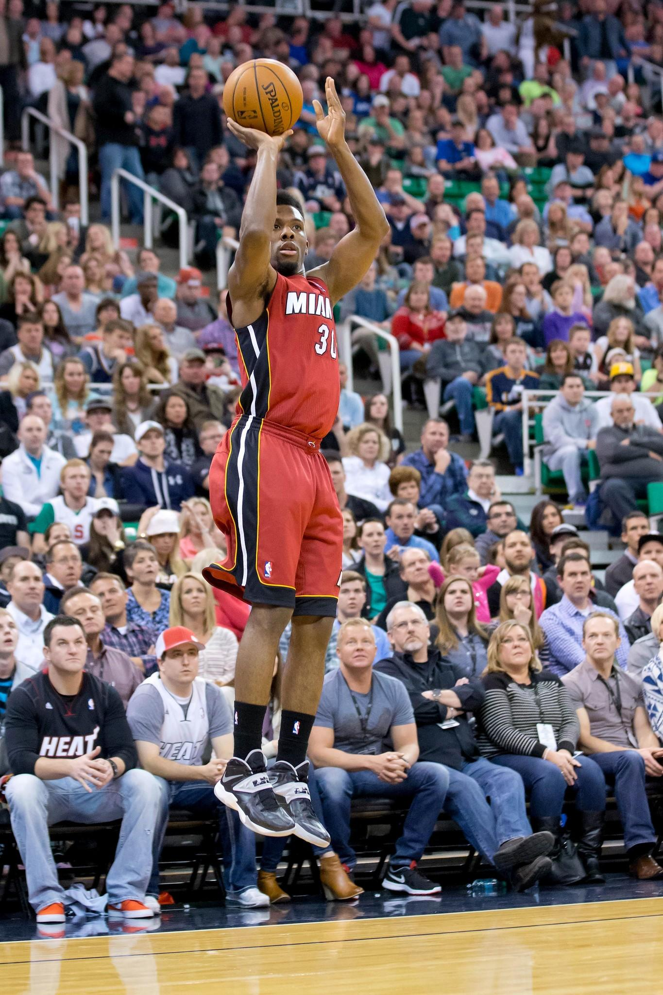 Feb 8, 2014; Salt Lake City, UT, USA; Miami Heat point guard Norris Cole (30) shoots during the first half against the Utah Jazz at EnergySolutions Arena. Mandatory Credit: Russ Isabella-USA TODAY Sports ORG XMIT: USATSI-140986