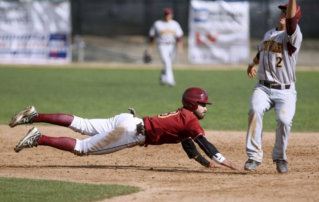 Glendale Community College's Nick Padilla dives back to second base on an attempted pick off during a nonconference home game versus Victor Valley College at Stengel Field on Saturday. (Raul Roa/Staff Photographer)