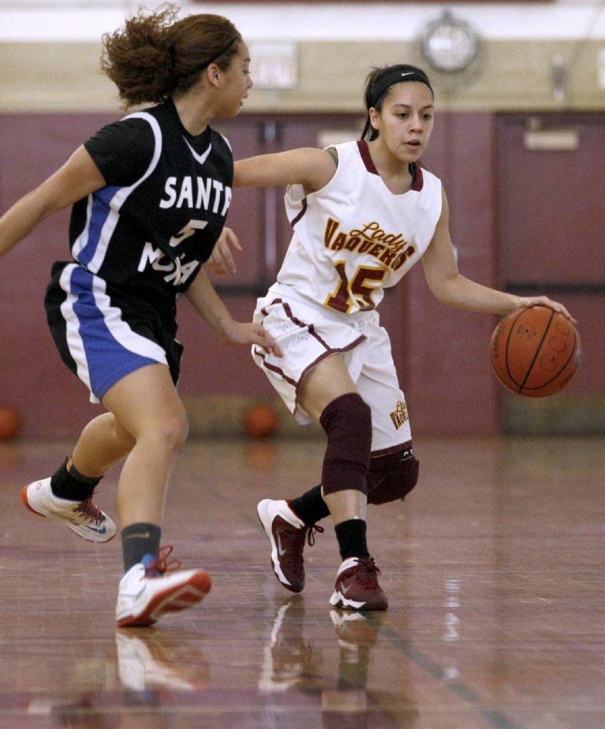 Glendale College basketball player #15 Elsie Mejia dribble drives during game vs. Santa Monica College at home in Glendale on Saturday, Feb. 8, 2014. (Raul Roa/Staff Photographer)