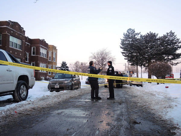 Police investigate the scene where a 42-year-old man was fatally shot in the 4500 block of West Monroe Street early on Feb. 9.