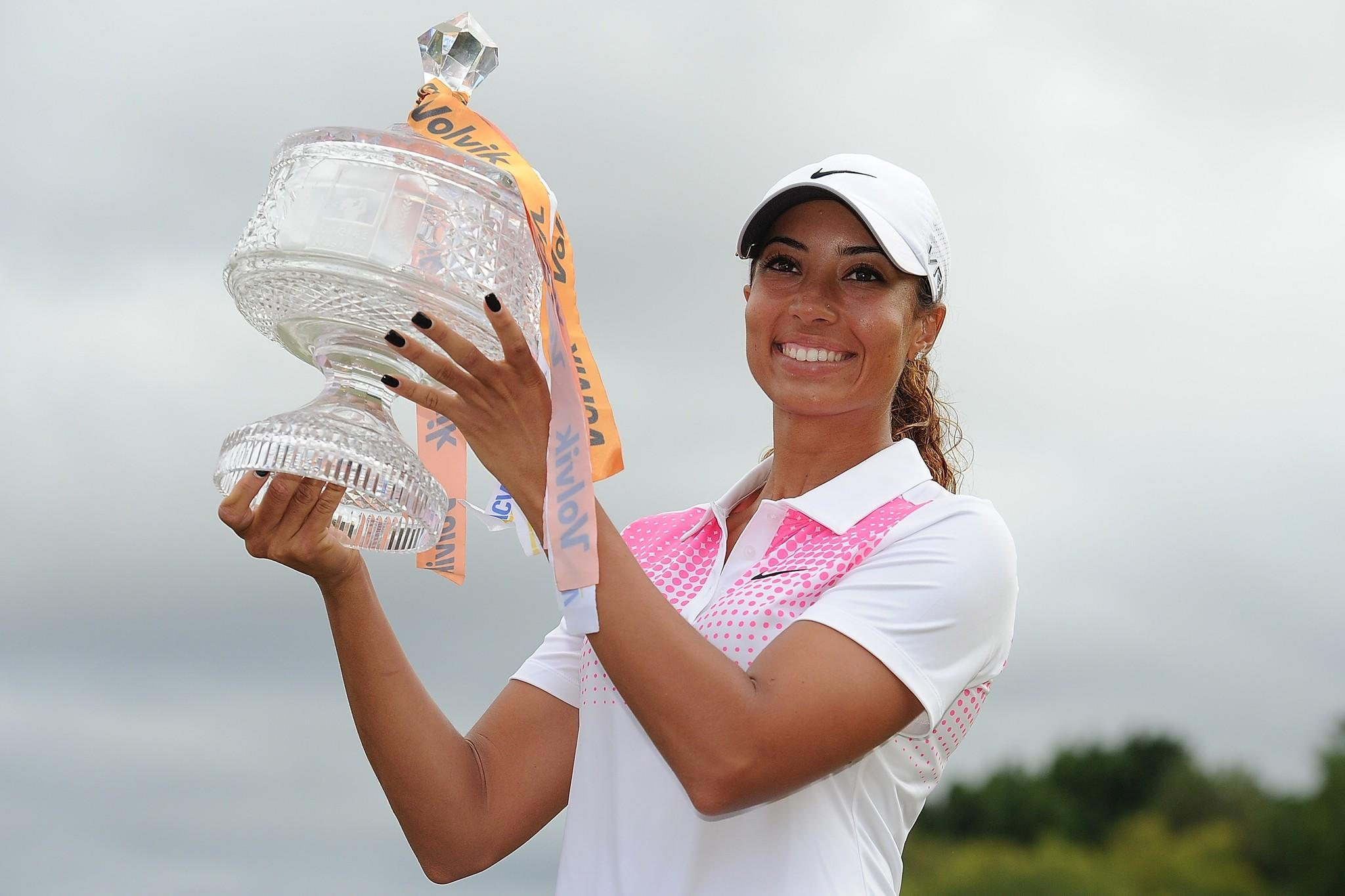 Cheyenne Woods of the United States holds the winner's trophy at the 2014 Ladies Masters at Royal Pines Resort on the Gold Coast, Australia.
