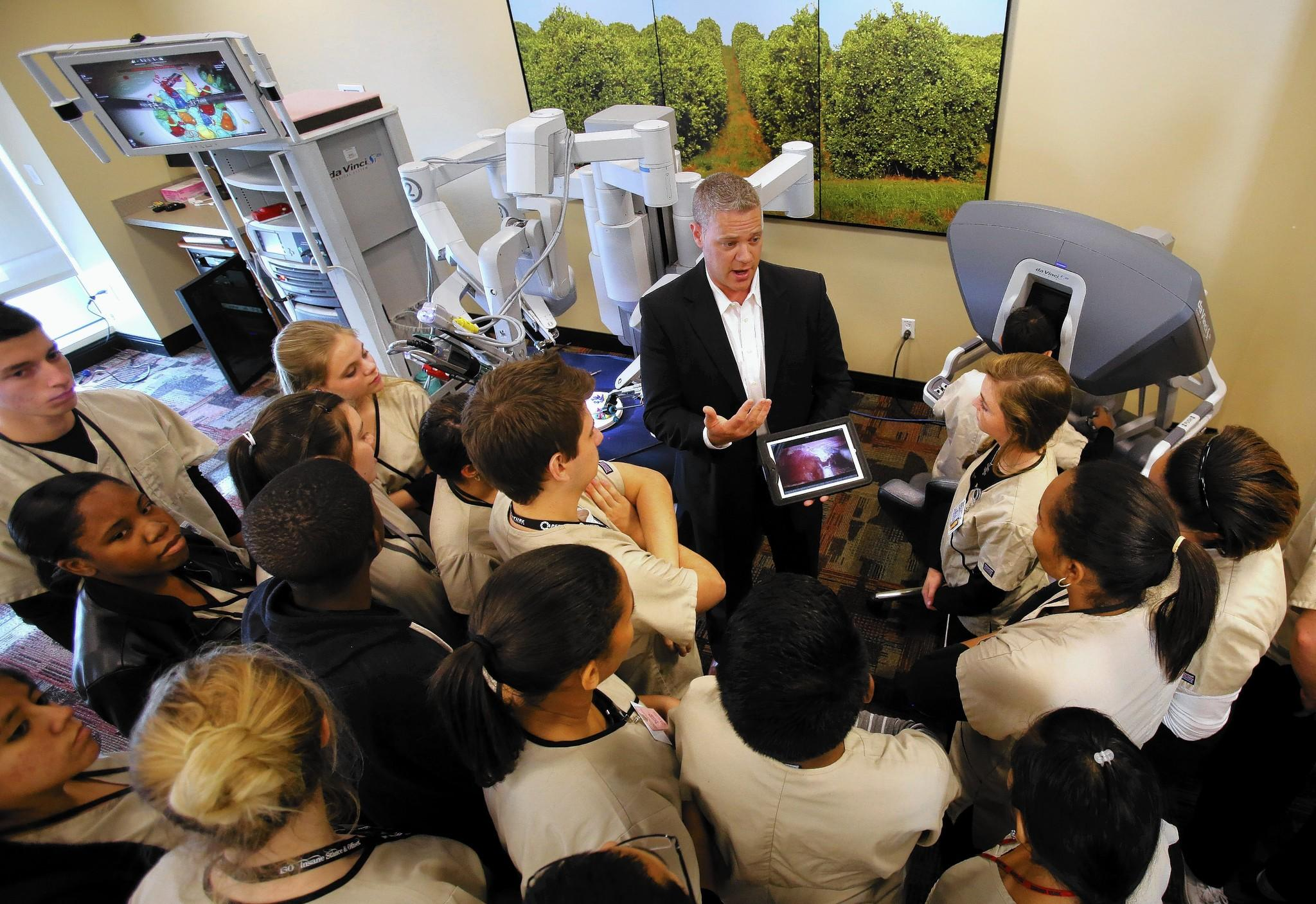 Kevin Foster of da Vinci Surgical Systems demonstrates the surgery robot to East Ridge High School Healthcare Academy students, at South Lake Hospital, in Clermont, Thursday, Jan. 23, 2014. (Joe Burbank/Orlando Sentinel) B583482322Z.1