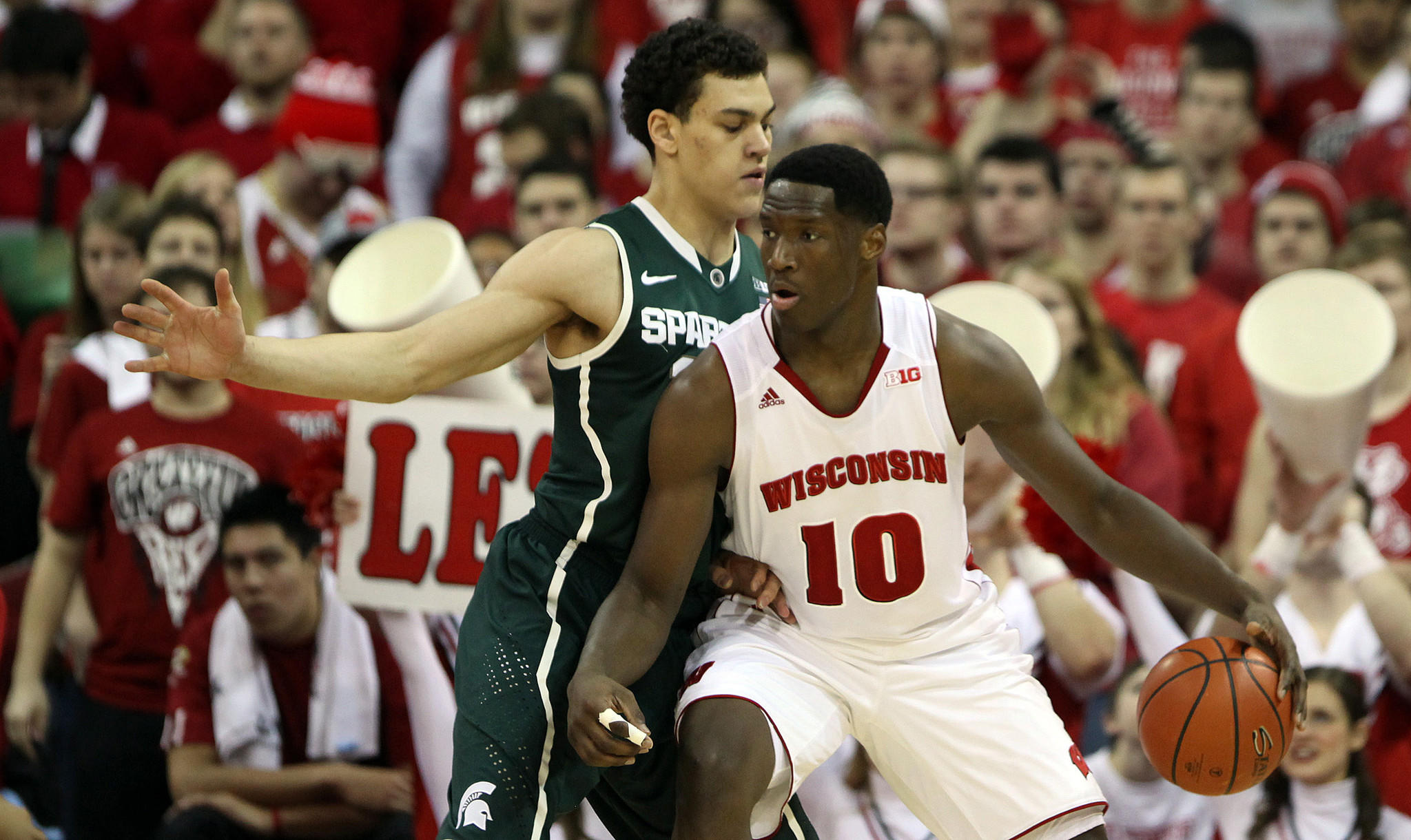Wisconsin's Nigel Hayes dribbles the ball as Michigan State's Gavin Schilling defends during the first half.