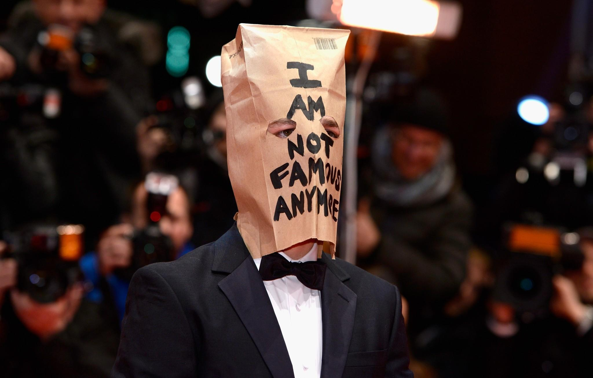 "Shia LaBeouf attends the ""Nymphomaniac"" premiere at the 64th Berlin International Film Festival wearing a paper bag on his head."