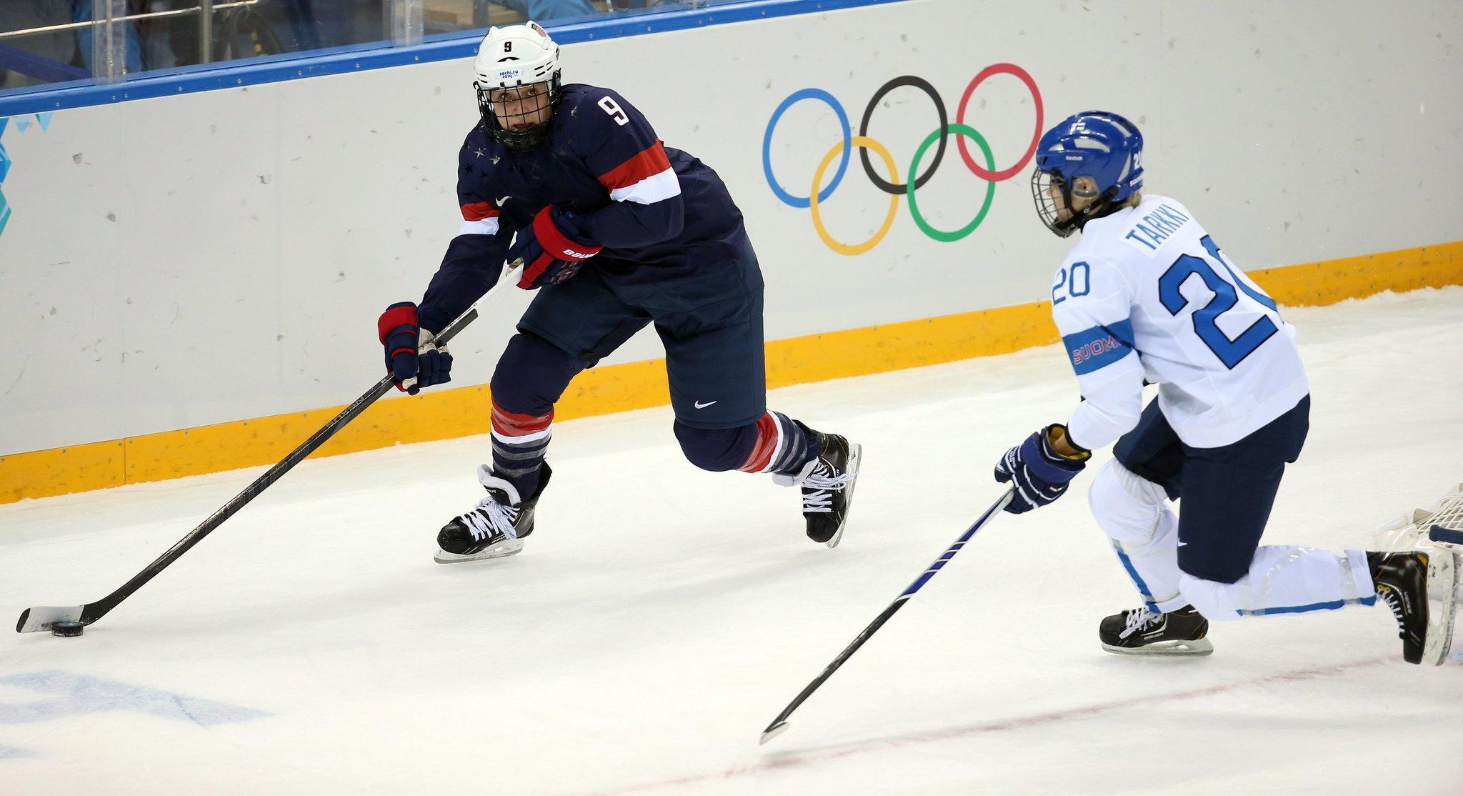 U.S. defenseman Megan Bozek (9) looks to pass against Finland defenseman Saija Tarkki (20) during the first perio.