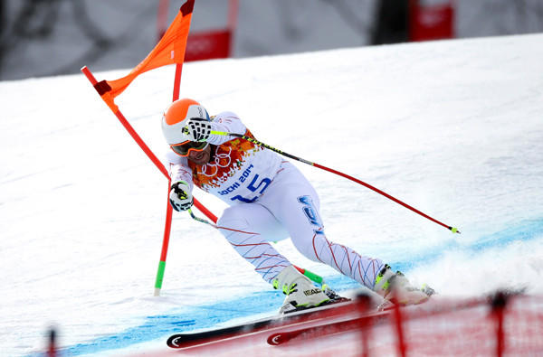 American skier Bode Miller hits a gate during his Sochi Olympics downhill run Sunday at Rosa Khutor Alpine Center.