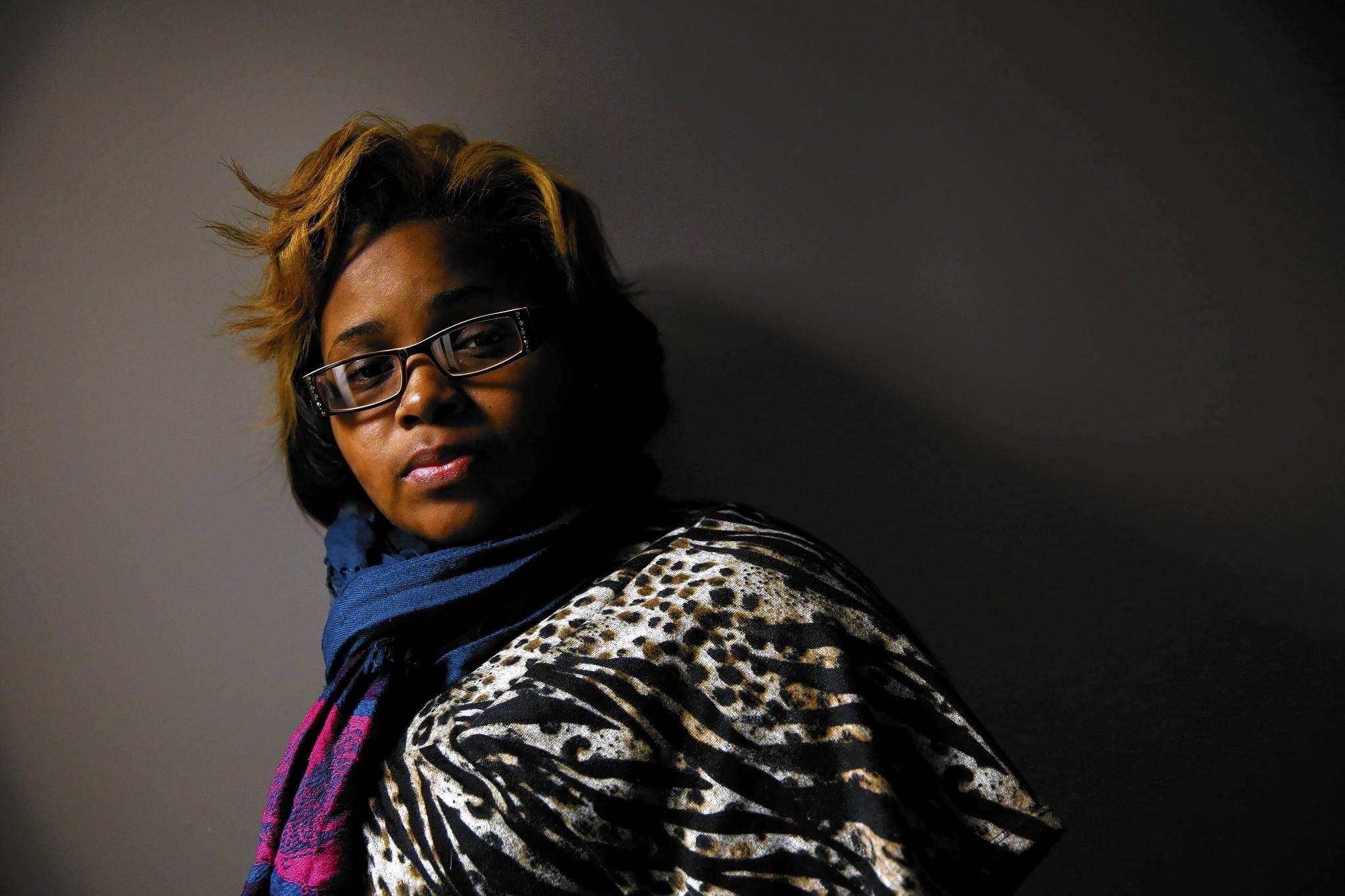 Kwamesha Sharp, 19, is suing the village of Harvey over a police arrest and her miscarriage.
