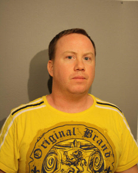 Brian Mayhall, 39, an Edgewater Beach man accused of growing marijuana plants inside his North Side apartment.