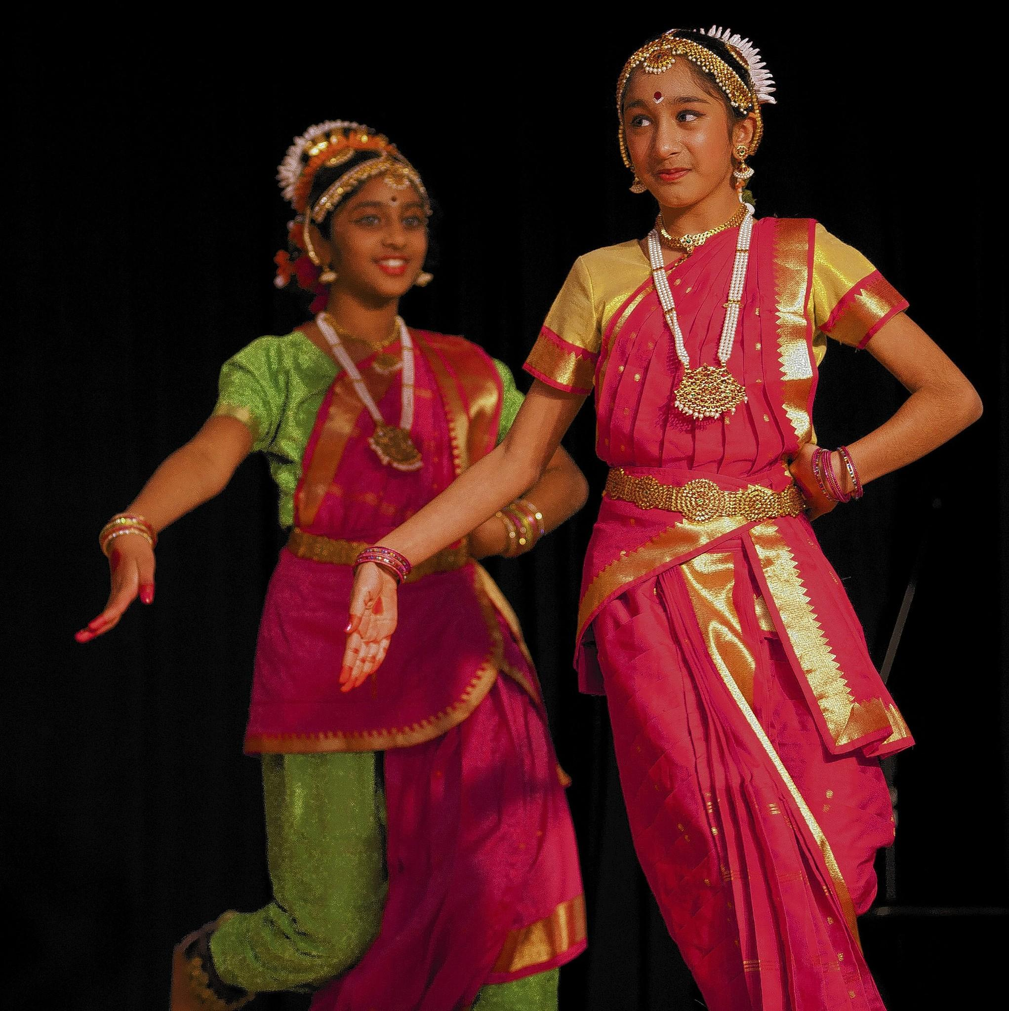 Maya Parekh (right) and Sunayana Jampanaboyana perform a traditional dance at the 25th annual Festival of Saraswati Puja at the Lehigh Valley Hindu Temple in Allentown.